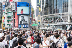 Pedestrians crossing the busiest crosswalk in the world in the Shibuya district in Tokyo, Japan. Royalty Free Stock Images