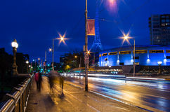 Pedestrians crossing Princes Bridge in Melbourne at night Royalty Free Stock Photography