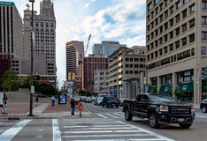 Pedestrians crossing the road in Baltimore. Baltimore, Maryland, USA - July 11, 2017: Pedestrians crossing in a crosswalk in downtown Baltimore near the city Stock Photos