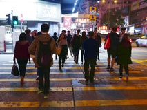 Pedestrians Crossing Road in Crowded City Stock Image