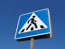 Pedestrians crossing sign. A blue road sign Stock Photo