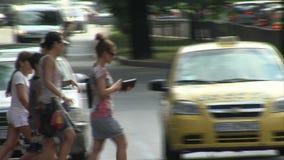 Pedestrians crossing the street in the center of Varna, Bulgaria stock video