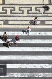 Pedestrians crossing the street Stock Photos