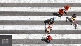 Pedestrians crossing the street Royalty Free Stock Photos