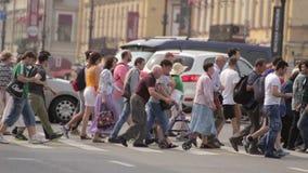 Pedestrians Crossing Street Slow Motion Saint Peterburg 01 August 2016. Pedestrians Crossing Street Slow Motion Big City Traffic Saint Peterburg 01 August 2016 stock video footage