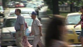 Pedestrians crossing the street in Varna, Bulgaria stock footage