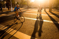 Pedestrians and cyclist, Port Vell, Barcelona, Spain Stock Images