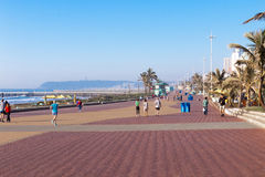 Pedestrians and Cyclists on Paved Beachfront Promenade stock photography