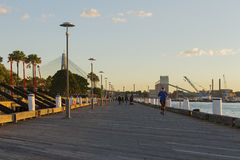 Pedestrians at Darling Island Park wharf in Sydney with the Anza. Sydney, Australia - June 24, 2017: A runner and pedestrians at Darling Island Park wharf in Royalty Free Stock Photography