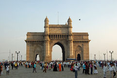 Pedestrians enjoying the evening at the Gateway to India Mumbai Royalty Free Stock Images