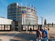 Pedestrians, European Union Flag fly at half mast after Manchest Stock Photo