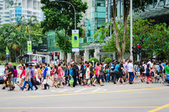 Pedestrians on famous street Orchard Road in Singapore. SINGAPORE - 01 JAN 2014: Crowd on pedestrians crossing on famous street Orchard Road in Singapore Stock Photos