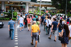 Pedestrians on famous street Orchard Road in Singapore. SINGAPORE - 01 JAN 2014: People on pedestrians crossing on famous street Orchard Road in Singapore Stock Images