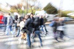 Pedestrians filling crosswalks in city Stock Photos