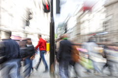 Pedestrians filling crosswalks in city Stock Image