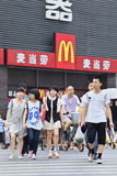 Pedestrians in front of McDonalds. XIANG YANG-CHINA-JULY 3, 2012. Pedestrians in front of McDonalds on July 3, 2012 in Xiang Yang. It took McDonalds 19 years to Royalty Free Stock Photo