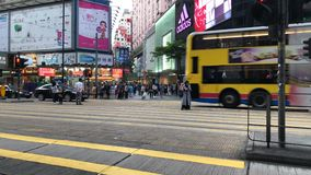 Pedestrians go through the underground tunnel at rush hour in central district. Causeway Bay, Hong Kong  - April 01, 2017 : Pedestrians crossing the street in stock video