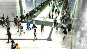 Pedestrians go through the underground tunnel at rush hour in central district. Central, Hong Kong  - March 29, 2017 : Pedestrians go through the underground stock footage