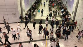 Pedestrians go through the underground tunnel at rush hour in central district. Central, Hong Kong  - March 29, 2017 : Pedestrians go through the underground stock video