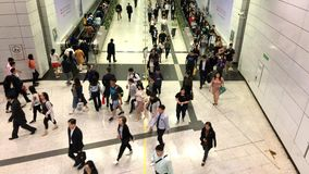 Pedestrians go through the underground tunnel at rush hour in central district of Hong Kong stock video