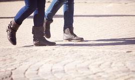 Pedestrians Legs Walking On The Sidewalk Royalty Free Stock Images