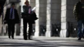 Pedestrians on a London pavement. Fast motion video footage of anonymous pedestrians and office workers walking along a London pavement stock video footage