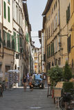 Pedestrians on the Lucca narrow street Royalty Free Stock Image