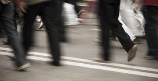 Pedestrians in modern city street Stock Image