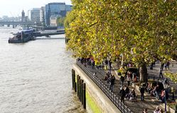 Pedestrians on the North Bank of the River Thames, London Royalty Free Stock Image