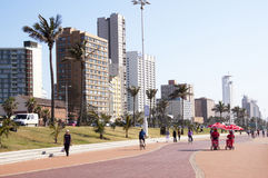 Pedestrians on Paved Promenade on Durban Beach Front Royalty Free Stock Photos