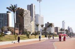 Pedestrians on Paved Promenade on Durban Beach Front Royalty Free Stock Photos