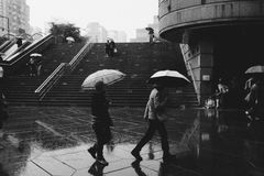 Pedestrians in rain in black and white Stock Photography