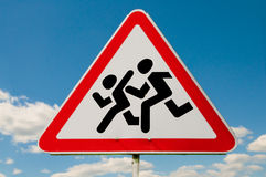 Pedestrians in road sign. And a big blue sky Stock Photography