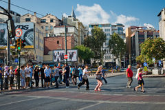 Pedestrians run across the road in downtown of Istanbul on Augus Stock Image