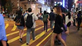 Pedestrians on zebra crossing street at night stock video footage