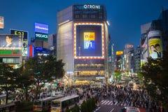 Pedestrians at Shibuya Crossing, Tokio, Japan. Tokyo, Japan - Nov 6: Pedestrians cross at Shibuya Crossing on November 6th in Tokyo, Japan, 2015 . Shibuya Royalty Free Stock Photos