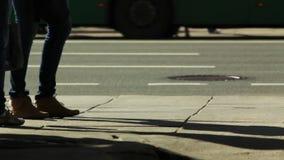 Pedestrians on a sidewalk - leg level shooting. HD 1080p: Pedestrians on a sidewalk - leg level shooting stock footage