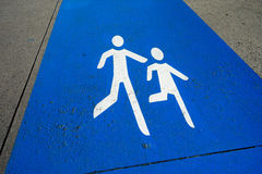 Pedestrians sign on the side walk Royalty Free Stock Photography