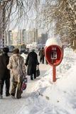 Pedestrians Soviet Phonebox in Russian Winter Stock Images