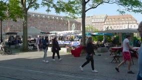 Pedestrians Strasbourg books flea market