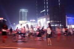 Pedestrians in the street at night Stock Image