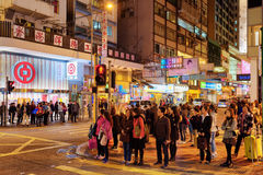 Pedestrians on streets of night city Hong Kong Stock Image