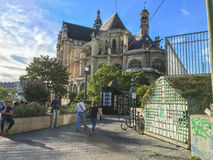 Pedestrians stroll toward Saint-Eustache church near Les Halles, Paris, France Stock Image