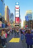 Pedestrians on 7th Avenue and Broadway in Times Square Stock Photo