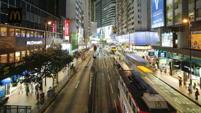 Pedestrians and traffic on Hennessy road near Times Square-Wan Chai Hong stock footage