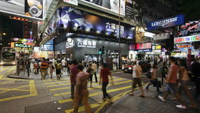 Pedestrians and traffic on hennessy road near times square-wan chai hong stock video footage