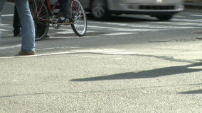 Pedestrians and traffic (14 of 16). Pedestrians and vehicles cross a city intersection stock footage