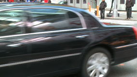 Pedestrians and traffic (12 of 16). Pedestrians and vehicles cross a city intersection stock footage