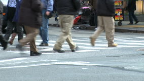 Pedestrians and traffic (3 of 16). Pedestrians and vehicles cross a city intersection stock video footage