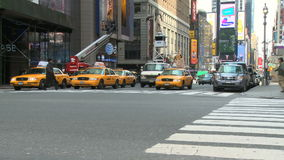 Pedestrians and traffic (16 of 16). Pedestrians and vehicles cross a city intersection (time lapse stock video